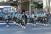 Scottish pipe band marches during Brisbane ANZAC day 2014 parade <br /> <br /> Editions:- Open Edition Print / Stock Image