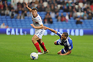 Cardiff City's Lee Peltier (on floor) is fouled by Wigan's Yanic Wildschut. EFL Skybet championship match, Cardiff city v Wigan Athletic at the Cardiff city stadium in Cardiff, South Wales on Saturday 29th October 2016.<br /> pic by Carl Robertson, Andrew Orchard sports photography.
