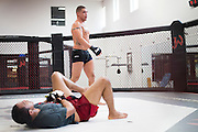 UFC lightweight Diego Sanchez of Albuquerque walks around the octagon after injuring his sparing partner at Jackson Wink MMA in Albuquerque, New Mexico on June 9, 2016.