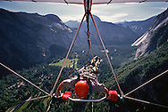 Yosemite National Park ranger Roger Lockwood flies his own kite off Glacier Point after all the other pilots have launched.   The sport in the park is allowed and is regulated and monitored by rangers.  July 1989.