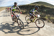 Azukile Simayile (left) and Sipho Madolo of team Meerendal SONGO Specialized wearing their Exxro leader jerseys during stage 3 of the 2014 Absa Cape Epic Mountain Bike stage race held from Arabella Wines in Robertson to The Oaks Estate in Greyton, South Africa on the 26 March 2014<br /> <br /> Photo by Greg Beadle/Cape Epic/SPORTZPICS