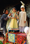 Children dressed as bride and groom in Pakistan