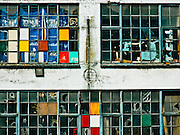 Windows of canal side warehouse, Amsterdam.