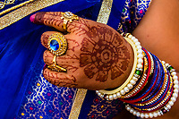 Veiled woman with Mehndi (Henna dye body art) on hands, Chhadi Mar Holi (local Holi celebration), Holi Festival (Festival of Colors), village of Gokul, near Mathura, Uttar Pradesh, India.