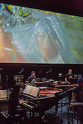 Brooklyn, NY - 20 January 2015. The dress rehearsal of Sufjan Stevens' Round-Up, with slow motion film of the Pendleton, Oregon Round-Up by Aaron and Alex Craig, music performd by Sufjan Stevens and Yarn/Wire. Musicians (L to R) Ning Yu (piano), Russell Greenberg, Ian Antonio, Sufjan Stevens (in the blue cap).