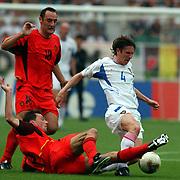 l-r; Belgium's Nico Van Kerckhoven tackles Russia's Alexei Smertin