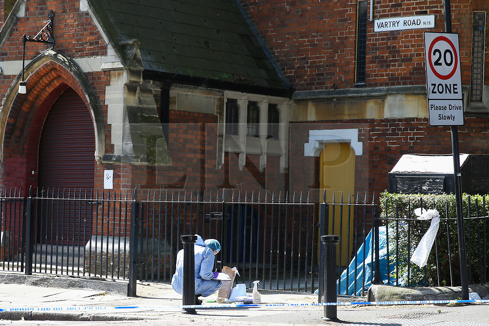 © Licensed to London News Pictures. 01/06/2019. London, UK. A forensic officer collecting evidence within the crime scene on Seven Sisters Road, near the junction of Vartry Road in Haringey, north London, where a man in his 30s was found suffering from a stab wound to his leg. Police were called by London Ambulance Service just after 3am on Saturday, 1 June 2019. The victims condition in unknown.  Photo credit: Dinendra Haria/LNP