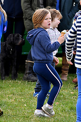 Mia Tindall enjoying an ice cream during the Land Rover Novice & Intermediate Horse Trials at Gatcombe Park on March 23, 2019.