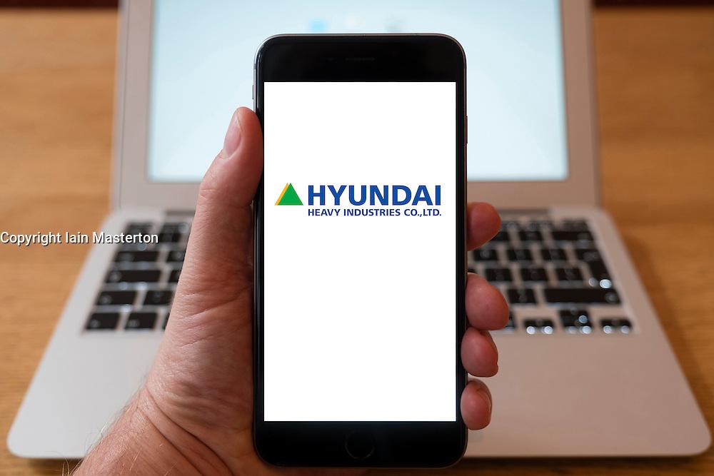 Using iPhone smartphone to display logo of  Hyundai Heavy Industrie co . Ltd