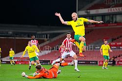 Joe Bursik of Stoke City saves at the feet of Norwich City's Teemu Pukki - Mandatory by-line: Nick Browning/JMP - 24/11/2020 - FOOTBALL - Bet365 Stadium - Stoke-on-Trent, England - Stoke City v Norwich City - Sky Bet Championship