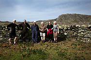Dr David Binnie (centre) pictured after a dry stone walling course on the the Inner Hebridean island of Colonsay on Scotland's west coast.  The island is in the council area of Argyll and Bute and has an area of 4,074 hectares (15.7 sq mi). Aligned on a south-west to north-east axis, it measures 8 miles (13 km) in length and reaches 3 miles (4.8 km) at its widest point, in 2019 it had a permanent population of 136 adults and children.