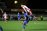 Stevanage attacker James Ball (7) fouling AFC Wimbledon striker Kweshi Appiah (9) during the EFL Trophy group stage match between AFC Wimbledon and Stevenage at the Cherry Red Records Stadium, Kingston, England on 6 November 2018.
