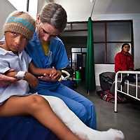 Jennifer Frydl examines a patient just after surgery. Oregon orthopedic doctors and support staff helped hundreds of Peruvian children in Coya, Peru performing corrective surgeries and therapy to improve their quality of life.
