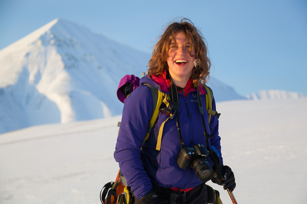Mylène Jacquemart sees direct sunlight for the first time from a mountainside in Koslådalen, Svalbard.