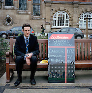 UK. London. The Village Green: From Blair to Brexit.<br /> A story on the relationship between the Media, Politicians and the public as they come together on College Green, a small patch of land next to The Houses of Parliament in Westminster. <br /> Photo shows a man from the betting company Ladbrokes showing the odds on the outcome of the 2005 General Election.<br /> Photo©Steve Forrest/Workers' Photos