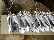 Spoons made from recycled aluminium sourced from Vietnam War debris and melted in an earthen kiln in Ban Naphia, a remote Tai Phouan village in mountainous Xieng Khouang Province in Northern Laos. Laos is the most bombed country, per capita, in the world with more than two million tons of ordnance dropped on it during the Vietnam War from 1963 to 1974.12 artisan families began transforming war scrap into spoons (150,000 per year) in the 1970s to supplement subsistence farming activities. Supported by the Swiss NGO Helvetas, the project works to make the scrap metal supply chain safer for artisans and scrap collectors by collaborating with organisations such as Mines Advisory Group (MAG) that specialise in unexploded ordnance removal and education. More recently the villagers have started making bracelets and other items.