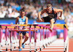 France's Kevin Mayer (right) jumps a hurdle as Authorised Neutral Athlete Ilya Shkurenev walks injured in the 110m Hurdles element of the Men's Decathlon during day nine of the 2017 IAAF World Championships at the London Stadium.