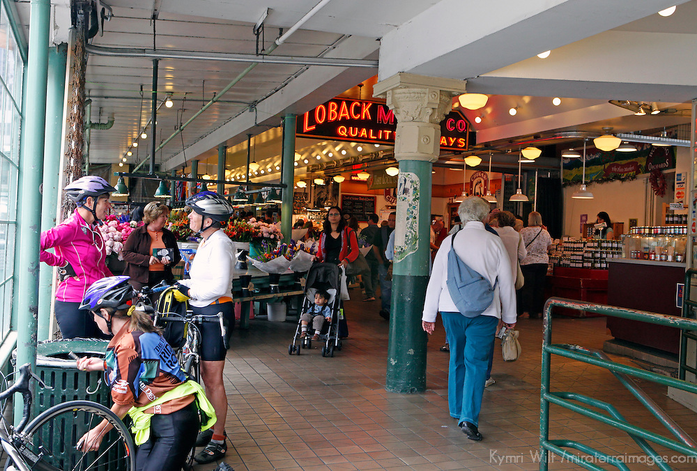 USA, Washington, Seattle. Cyclists at Pike Place Market, a Seattle landmark.