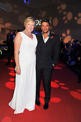 CLARE HORTON Chief Executive Officer? Battersea Dogs & Cats Home and PETER ANDRE at the annual Collars & Coats Gala Ball in aid of Battersea Dogs & Cats Home held at Battersea Evolution, Battersea Park, London on 11th November 2011.