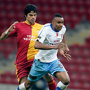 Galatasaray's Gokhan ZAN (L) and Trabzonspor's Jakson Avelino COELHO (R) during their Turkish superleague soccer derby match Galatasaray between Trabzonspor at the TT Arena in Istanbul Turkey on Sunday, 10 April 2011. Photo by TURKPIX