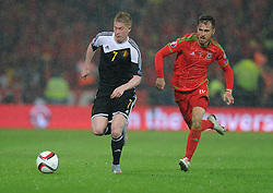 Aaron Ramsey of Wales (Arsenal) chases down Kevin De Bruyne of Belgium (Wolfsburg) - Photo mandatory by-line: Alex James/JMP - Mobile: 07966 386802 - 12/06/2015 - SPORT - Football - Cardiff - Cardiff City Stadium - Wales v Belgium - Euro 2016 qualifier