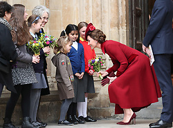 Duchess of Cambridge speaks to school children as she leaves after the Commonwealth Service at Westminster Abbey, London on Commonwealth Day. The service is the Duke and Duchess of Sussex's final official engagement before they quit royal life.