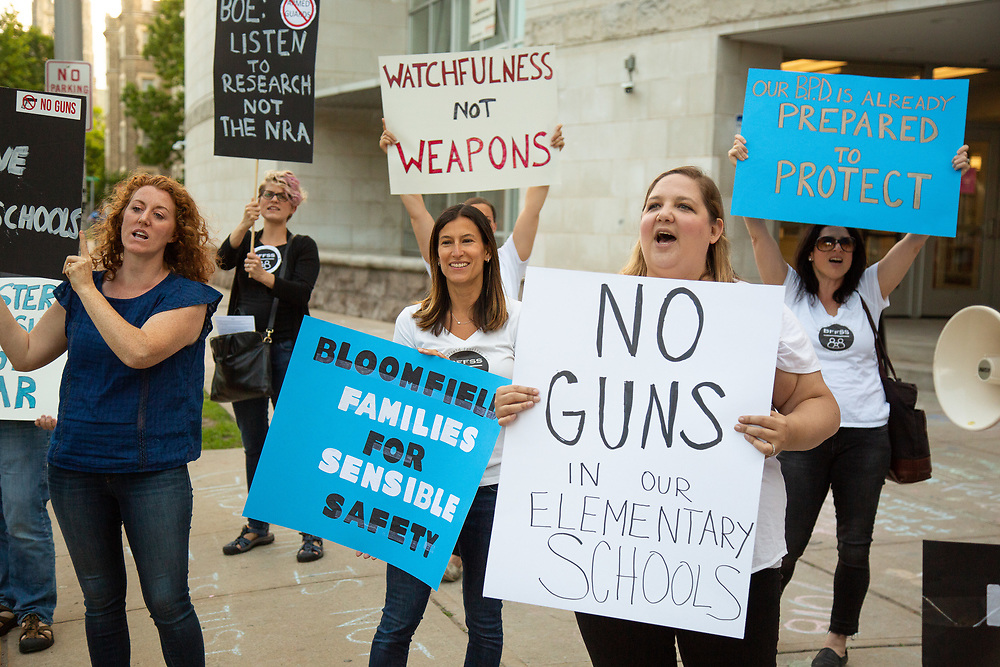 Bloomfield residents and parents of school children protest a plan by the Bloomfield Board of Education to hire armed officers for each elementary school. <br /> 6/5/18 Photo by John O'Boyle
