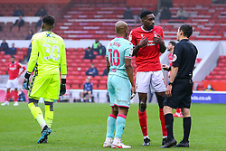 Referee Tony Harrington talks to Sammy Ameobi of Nottingham Forest and Andre Ayew of Swansea City  - Mandatory by-line: Nick Browning/JMP - 29/11/2020 - FOOTBALL - The City Ground - Nottingham, England - Nottingham Forest v Swansea City - Sky Bet Championship