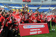 Cardiff city players celebrate as capt Mark Hudson lifts the championship trophy.NPower championship, Cardiff city v Bolton Wanderers at the Cardiff city Stadium in Cardiff, South Wales on Saturday 27th April 2013. pic by Andrew Orchard,  Andrew Orchard sports photography,