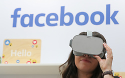 A woman uses an Oculus virtual reality headset at the Facebook stand during the Dublin Tech Summit, held at the Royal Dublin Society (RDS) in Dublin, Ireland.