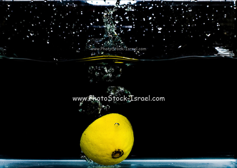 Lemon dropped into water