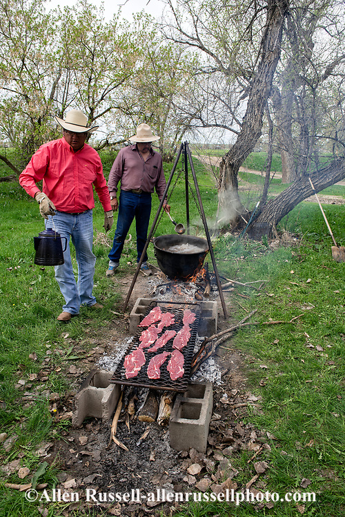 Crow Indian Reservation, Montana, Henry Real Bird sons Jack and John, helping cook at sister Lucy Real Bird graduation celebration