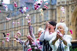 EMBARGOED: Nans knit pairs of balls outside Parliament as part of an effort by campaign group Fathers 4 Justice to highlight the grandparents who are deprived of access to their grandchildren when parents' divorce terms refuse fathers access to their children. London, June 04 2018.