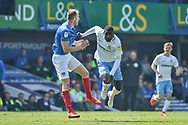 Portsmouth Defender, Matt Clarke (5) and Coventry City Forward, Amadou Bakayoko (21) challenge  during the EFL Sky Bet League 1 match between Portsmouth and Coventry City at Fratton Park, Portsmouth, England on 22 April 2019.