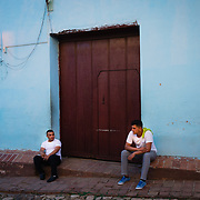 Two Cuban restaurant workers taking a break before a busy shift