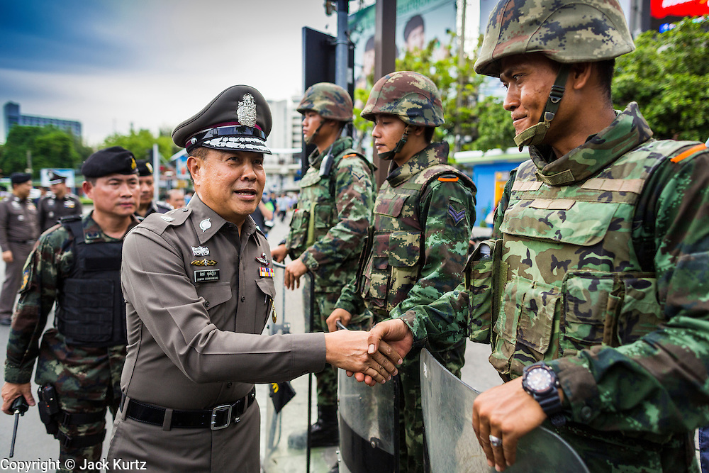 29 MAY 2014 - BANGKOK, THAILAND: General SOMYOT POOMPANMOUNG, deputy national police chief of Thailand, thanks soldiers for their work securing Victory Monument. More than 1,300 soldiers and police were used to prevent an outbreak of protests at the Monument.  After a series of protests around Victory Monument earlier in the week, the Thai army Thursday shut down vehicle access to the area, one of the main intersections in Bangkok, and kept people out of the area. Thousands of soldiers surrounded the Monument and effectively locked the area down. There were no protests at Victory Monument for the first time in the week since the coup deposed the elected civilian government.   PHOTO BY JACK KURTZ