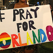 A woman holds a sign during a vigil at the Dr. Phillips Center for the Performing Arts for the victims of a mass shooting at the Pulse nightclub Monday, June 13, 2016, in Orlando, Florida.  A gunman killed dozens of people in a massacre at the crowded gay nightclub in Orlando on Sunday, making it the deadliest mass shooting in modern U.S. history. (Alex Menendez via AP)