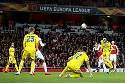 Arsenal's Mesut Ozil (third right) takes a shot on goal