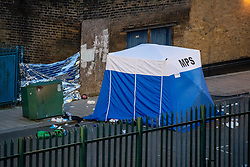 © Licensed to London News Pictures. 08/03/2021. London, UK. A forensic tent on Penshurst Road where a man was found with fatal stab injuries, a second man, who is 18-years-old, was treated for stab wounds and taken to hospital. Photo credit: Peter Manning/LNP