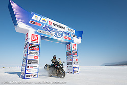 Cold weather adventure motorcyclist and author Alessandro Ciceri, better known as Wizz (@wizz_inwiaggio), after riding 6,200 mile (10,000 km) from his home in Italy in the middle of winter, seen here at the entrance to the Baikal Mile Ice Speed Festival. Maksimiha, Siberia, Russia. Monday, March 2, 2020. Photography ©2020 Michael Lichter.