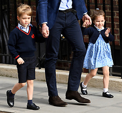 Prince George and Princess Charlotte enter the Lindo Wing at St Mary's Hospital in Paddington, London. Photo credit should read: Doug Peters/EMPICS Entertainment