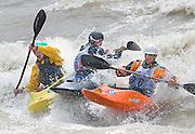 NEWS&GUIDE PHOTO / PRICE CHAMBERS.NEWS&GUIDE PHOTO / PRICE CHAMBERS.From left, Evan Howard, Carson King and Forrest Maclean vie for position on King's Wave during the 2009 Wyoming Whitewater Championships. The event raises money for the Jackson Hole Kayak Club and pitts local paddlers against each other in a freestyle competition.