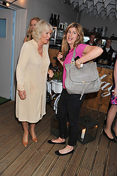 HRH The DUCHESS OF CORNWALL and her niece KATE ELLIOT at a party to celebrate the publication on 'Let's Eat: Recipes From My Kitchen Notebook' by Tom Parker Bowles held at Selfridge's Rooftop. Selfridge's, Oxford Street, London on 27th June 2012.