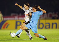 Serravalle 06/9/2006<br /> Match of Qualify European Football 2008 SanMarino-Germany<br /> Germany Torsten Frings fights for the ball with SanMarino Manuel Marani<br /> Photo Luca Pagliaricci Inside