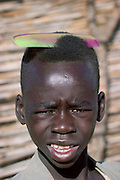 The Breidjing Refugee Camp, Eastern Chad on the Sudanese border shelters 30,000 people who have fled their homes in Darfur, Sudan. This boy is getting ready for the feast to celebrate the end of Ramadan. (Supporting image from the project Hungry Planet: What the World Eats.)