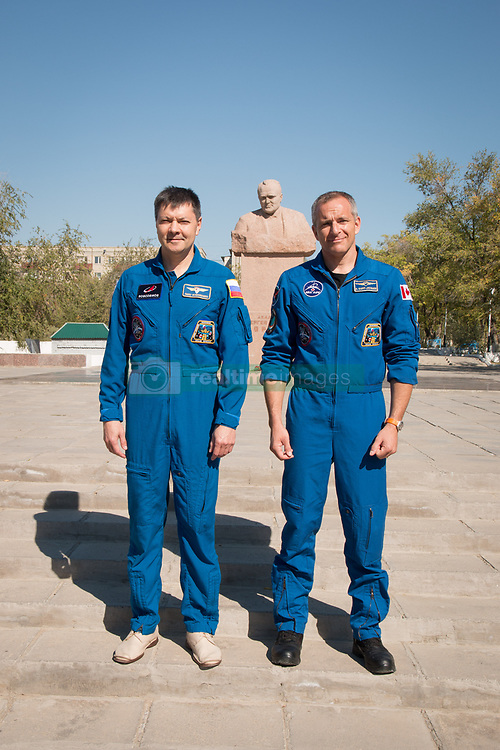 During a tour of the city of Baikonur, Kazakhstan, Expedition 57 backup crewmembers Oleg Kononenko of Roscosmos (left) and David Saint-Jacques of the Canadian Space Agency (right) pose for pictures Sept. 27 at the statue of Sergei Korolev, the Russian space designer icon, during traditional pre-launch ceremonies. They are the backups to the prime crew, Alexey Ovchinin of Roscosmos and Nick Hague of NASA, who will launch Oct. 11 on the Soyuz MS-10 spacecraft from the Baikonur Cosmodrome in Kazakhstan for a six-month mission on the International Space Station.<br /> <br /> NASA/Victor Zelentsov