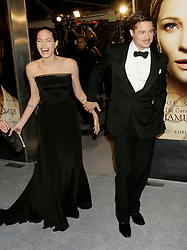 """Angelina Jolie and Brad Pitt arrive for the premiere of the film, """"The Curious Case of Benjamin Button"""" at the Mann's Village theater, in Los Angeles."""