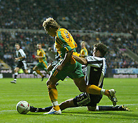 Fotball<br /> Foto: SBI/Digitalsport<br /> NORWAY ONLY<br /> <br /> Newcastle United v Norwich<br /> Carling Cup Third Round, St James' Park, Newcastle upon Tyne 27/10/2004.<br /> <br /> An attack by Norwich's Darren Huckerby (L) is brought to an end by an excellent tackle from Newcastle's Ronny Johnsen (R).