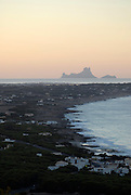 Sunset view of Es Vedra and part of Formentera, from La Mola