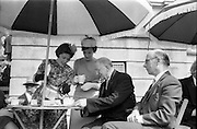 06/06/1962<br /> 06/06/1962<br /> 06 June 1962<br /> College Races at Trinity College, Dublin. President Eamon de Valera (centre) and Prof. M.H. Newman (Manchester University) enjoying afternoon tea provided by Trinity College Students, Jenepher Grange, (Belfast) and Madeline Longford, when they attended the College Races at College Park, Dublin.